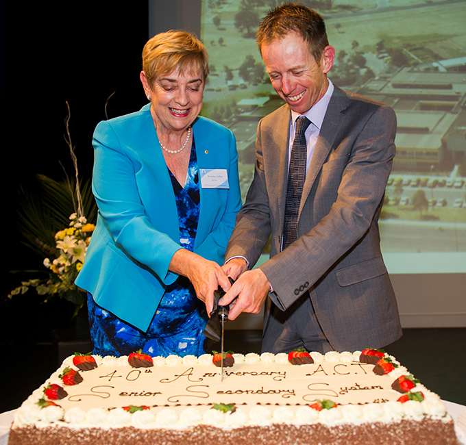 Photo of the Board Chair, Rosemary Follett, and the Minister for Education, Shane Rattenbury, cutting the cake at the ACT Board of Senior Secondary Studies 40th birthday celebrations.