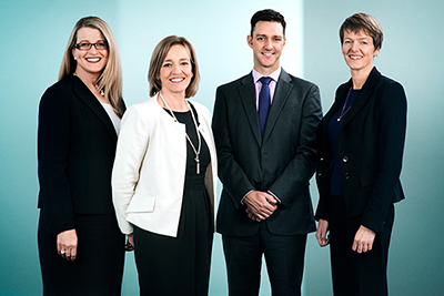 Photo of Senior Executive Team of the Education and Training Directorate, from left to right, Ms Meg Brighton, Ms Diane Joseph, Mr Stephen Gniel and Ms Leanne Cover.