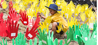 Photos showing Weetangera Primary School students contributing to 'Sea of Hands' display at the Australian Institute of Aboriginal and Torres Strait Islander Studies
