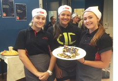 Three hospitality students serving food at Calwell High School
