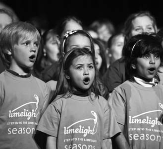 Photo of primary aged students singing at the gala performance of Limelight.