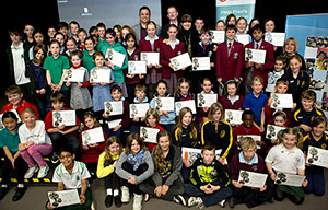 Group photo of primary school students holding Fred Hollows awards