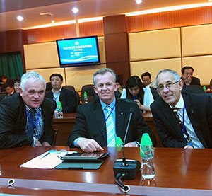 Photo of three principals at the 2013 International Forum for Secondary School Principals in China