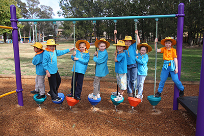 Photo of early childhood students on new play equipment