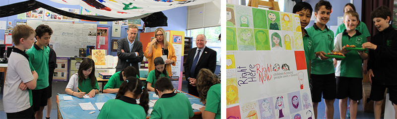 Photo of Black Mountain School art works. Turner Primary School students (left above) participating in the launch of the  Right Here Right Now project with keen observers, Mr Alasdair Roy, ACT Children and Young People Commissioner, Ms Sally Visser-Marchant teacher (Art) Turner School and Mr Mick Gentleman, MLA Minister for Children and Young People, and (right above) the students displaying their work.