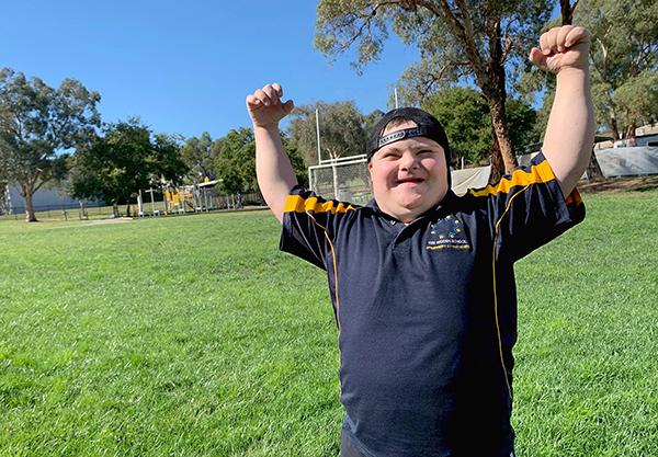 – student DJ, entertainer and ACT Down Syndrome Association 2019 Alderman Family Award recipient – striking his signature pose as The Ashman