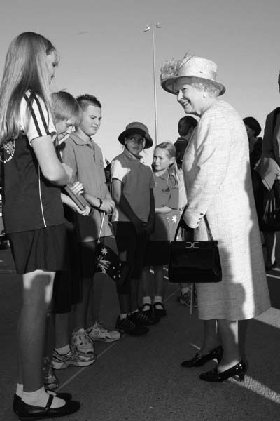Photo of Queen Elizabeth II of Australia talking to primary aged students from different Canberra schools.