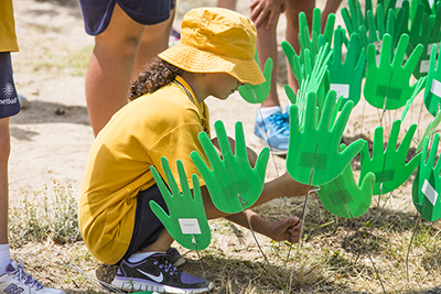 Photo of Aboriginal and Torres Strait Islander students participating in 'Sea of Hands' for cultural awareness