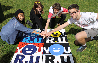 Photos showing showing students and activities at You R U Day attended by 400 students