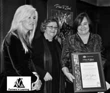 Waniassa School principal Karin Nargorka (right) is joined by Catherine O'Sullivan from the Department of Education, Employment and Workplace Relations (left) and Professor Jeannie Herbert from Charles Sturt University in receiving her school's Dare to Lead award