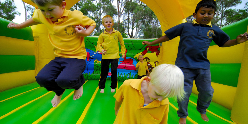 Photo of primary school students on jumping castle at Kingsford Smith School