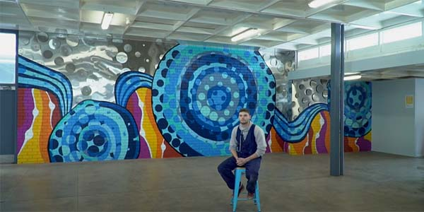 Mackenzie Saddler with his mural