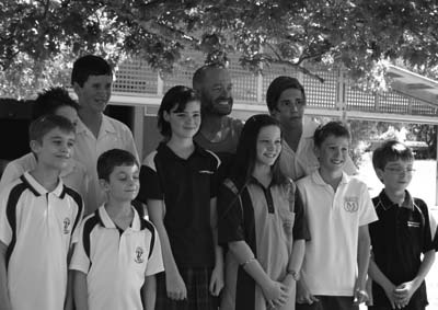 Photo of Adam Spencer a popular public figure posing with Zoe Clark and other students from around Australia who were attending the World Education Games in Sydney.