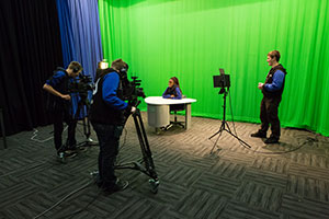 Photo of media students of the Gungahlin College preparing their media assignment