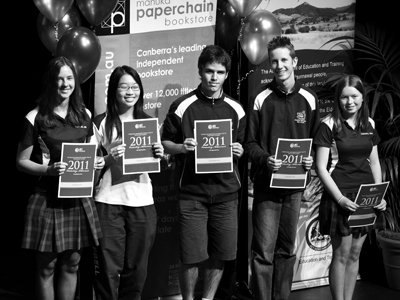 Photo of five students receiving Paper Chain Awards for excellence in academic work and extracurricular activities including peer mentoring, sports, state and national competitions and charity work during their year 10 studies.