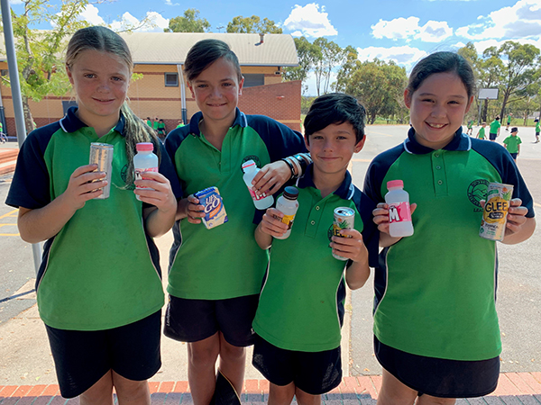 Bonython Primary School students Makayla Dillon, 11, Tyler Holdway, 11, Eli Boyle, 10 and Aaliyah Priest, 10, with some of the containers collected at their school.