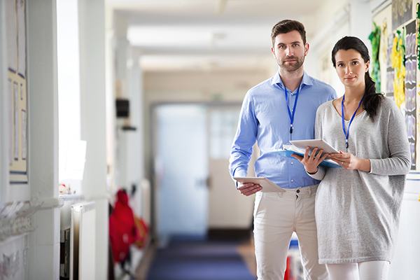 teachers in the corridor - iStock