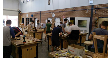 Students doing woodwork in school workshop