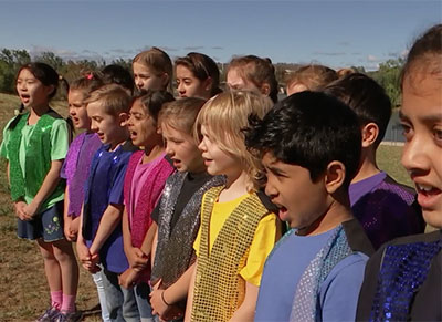 Kids from all over Australia, in every territory and state, rang in the New Year with the traditional song Auld Lang Syne.