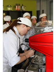 Hospitality student making coffee at school