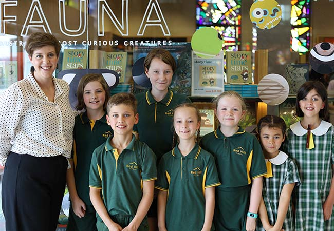 Avid readers and aspiring authors from Red Hill Primary School with Teacher Librarian Emma Cox.
