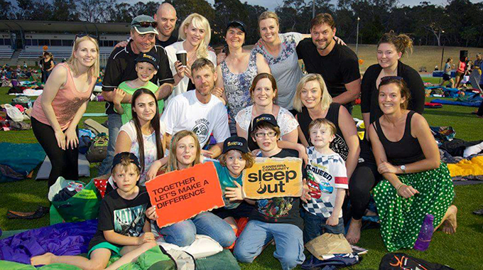 Photo of a group of parents, teachers and students at the Community Sleepout