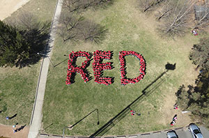 Photo of students forming the acronym RED: Respect, Equity and Diversity