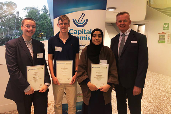 Canberra College scholarship recipients Jaime Ferguson, Lachlan Rowe and Maryam Mansuri with Principal Michael Battenally