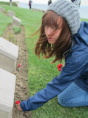 Photo of Beth Downing laying flower at the ANZAC Memorial in Gallipoli